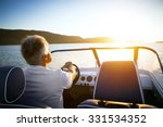 Mature Man Driving Speedboat