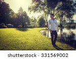 handsome young man on a lake's... | Shutterstock . vector #331569002