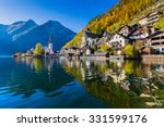 Stock photo scenic picture postcard view of famous hallstatt mountain village with hallstatter see in the 331599176