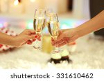 clinking glasses of champagne... | Shutterstock . vector #331610462