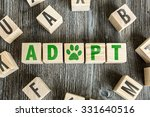 Small photo of Wooden Blocks with the text: Adopt