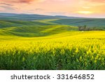 Spring fresh landscape of colorful fields, sunrise sky and beautiful hills valley - stock photo