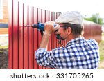 build a metal fence. an elderly ... | Shutterstock . vector #331705265