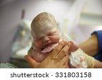 midwife holding up a vernix... | Shutterstock . vector #331803158