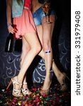 legs of girls with champagne... | Shutterstock . vector #331979408