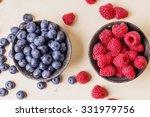 Blueberries And Raspberries In...