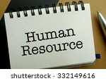 Human resource memo written on a notebook with pen - stock photo