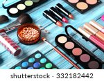 makeup brush and cosmetics on... | Shutterstock . vector #332182442
