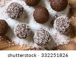 Coconut Rum Balls Being Covere...