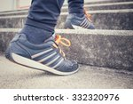 woman running on stairs | Shutterstock . vector #332320976