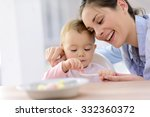 baby girl eating lunch with... | Shutterstock . vector #332360372