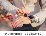 female touching her smartwatch  | Shutterstock . vector #332363462