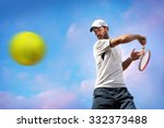 male tennis player in action | Shutterstock . vector #332373488