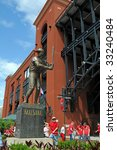 "Small photo of ST LOUIS – MAY 23: Baseball fans stand near the statue of Stan ""The Man"" Musial outside of Busch Stadium on May 23, 2009 in St Louis, Missouri. Busch Stadium is the home of the Saint Louis Cardinals."