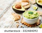 Avocado Hummus On A White Wood...