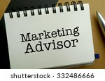 Marketing advisor memo written on a notebook with pen - stock photo