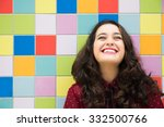 happy girl laughing against a... | Shutterstock . vector #332500766