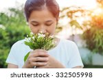 Asian Woman Smelling Flowers I...