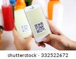 woman scanning voucher code... | Shutterstock . vector #332522672