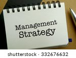 Management strategy memo written on a notebook with pen - stock photo