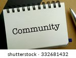 Community memo written on a notebook with pen - stock photo