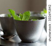 Small photo of Close up of a mint julep in a pewter cup.
