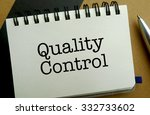Quality control memo written on a notebook with pen - stock photo