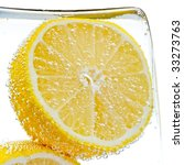 Lemon Slice In Water With...