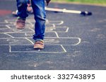 kid playing hopscotch on... | Shutterstock . vector #332743895