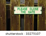 Sign On Wooden Gate Reads...