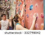 instructor guiding woman on... | Shutterstock . vector #332798042