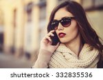 woman talking on phone outdoor | Shutterstock . vector #332835536