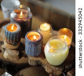 Small photo of Beautiful ablaze candle on the wooden table