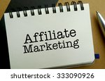 Affiliate marketing memo written on a notebook with pen - stock photo