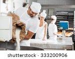 smiling male baker pouring... | Shutterstock . vector #333200906