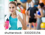 fit woman smiling at camera at... | Shutterstock . vector #333203156