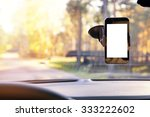 Stock photo mobile phone with blank screen in car windshield holder 333222602
