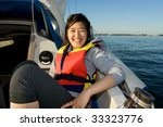 asian girl smiling on a sailing ...   Shutterstock . vector #33323776