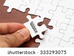 Stock photo placing missing a piece of puzzle with validation word 333293075