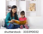mother reading a storybook to... | Shutterstock . vector #333390032