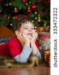 boy near a christmas tree | Shutterstock . vector #333472322