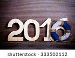 figures 2016 on old grey wooden ... | Shutterstock . vector #333502112