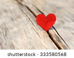 Stock photo valentines day red heart on old wood holidays card with copy space 333580568