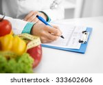 Doctor Nutritionist Writing...