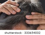 close up of man examining his... | Shutterstock . vector #333654032