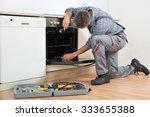 full length of repairman... | Shutterstock . vector #333655388