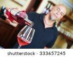 sommelier barman pouring wine...   Shutterstock . vector #333657245