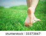 Woman Legs Walking On Green...