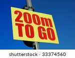 encouraging sign indicating the finish is only 200m away - stock photo