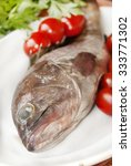 Small photo of fresh snapper of the mediterranea sea on the white dish